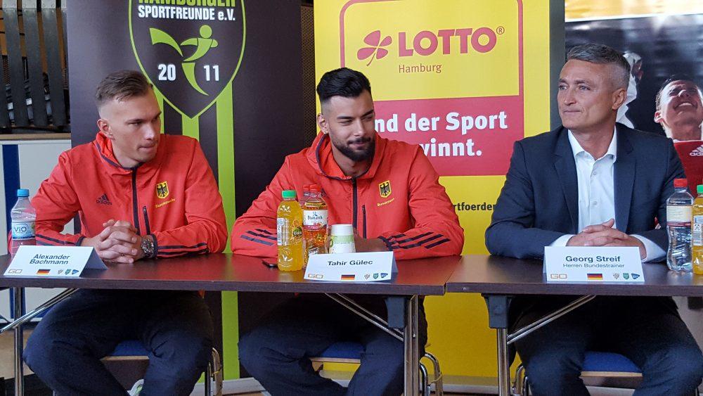 Die Weltmeister Alexander Bachmann und Tahir Gülec mit Bundestrainer Georg Streif
